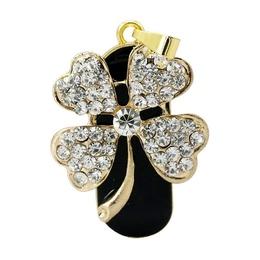 Оригинальная подарочная флешка Present FLW13 32GB (цветок на маленьком стебельке на черном фоне - 4 лепестка в форме сердца с камнями)